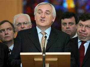 Bertie Ahern demonstrates the dark arts of Fianna Fáil while Lenihan and Cowen watch attentively.