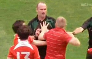 A GAA fan calmly attempts to explain his point of view to the referee.
