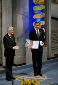Jagland publicly declares his love by giving a somewhat uncomfortable Obama the Nobel Peace Prize.