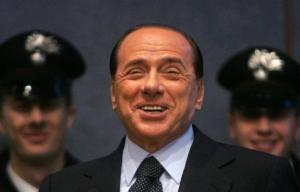 Berlusconi can't contain his joy at having two uniformed men at his back.