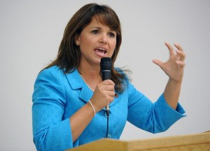 Christine O'Donnell explains the size of Sarah Palin's brass balls to the Tea Party faithful.