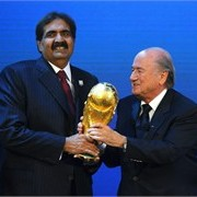 Sheikh Al-Thani wonders why the trophy ball is so round.