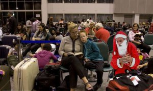 An increasingly gaunt Santa waits miserably with thousands of stranded travellers.