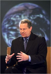 Al Gore smiles evilly as his plans for world domination, destruction, come to fruition.