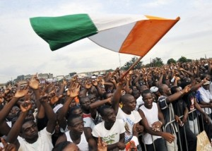 Ivorians protest under a confusingly Irish-looking flag.