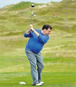 Cowen prepares to whack the balls off Ireland during the now infamous golf game.