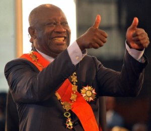 Laurent Gbagbo cheers the one person able to pronounce his name properly.
