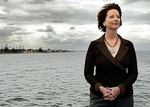 Gillard leads by example in casually ignoring the gigantic biblical flood behind her.