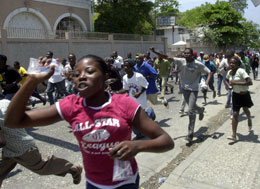 Haitians rush to greet the unprotected former tyrannical dictator.