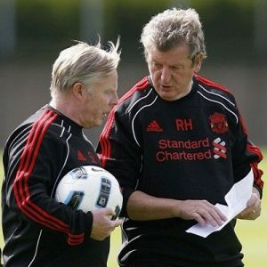Hodgson explains his new scouting report layout while the team waits impatiently for the ball.