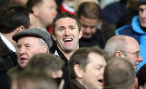As the advertisement is screened at White Hart Lane, Keane enjoys a laugh from his usual position.