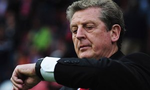 Roy Hodgson reminds Fernando Torres that punctuality is next to cleanliness in virtue.