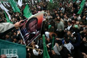 Pro-democracy activists in the Middle East march under the banner of their hero, George Bush.
