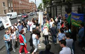 Drug dealers and their employees gather to lobby the Dail for stricter regulation.