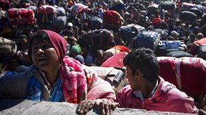 Libyan refugees look hopefully to the skies for the arrival of the UN bureaucrats.