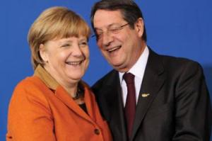 Anastasiades is desperate for a hug, but Merkel continues to refuse.
